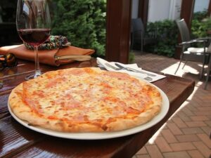 Cheese pizza and wine on a table