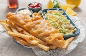 Fried wild caught cod with french fries and coleslaw